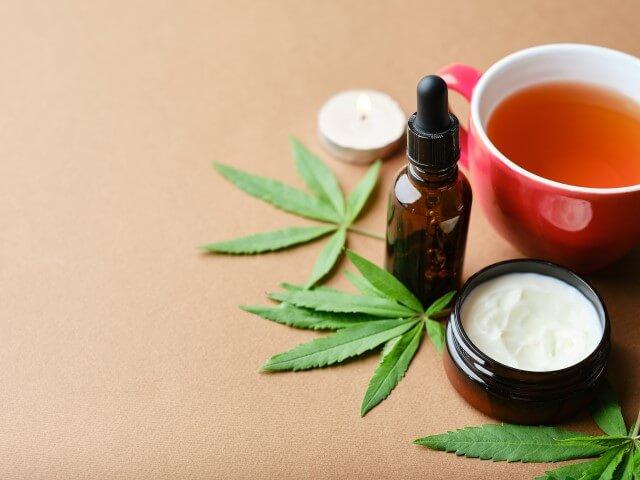cannabis cosmetic oil cream in jar bottle herbal a QM3YKQG 1